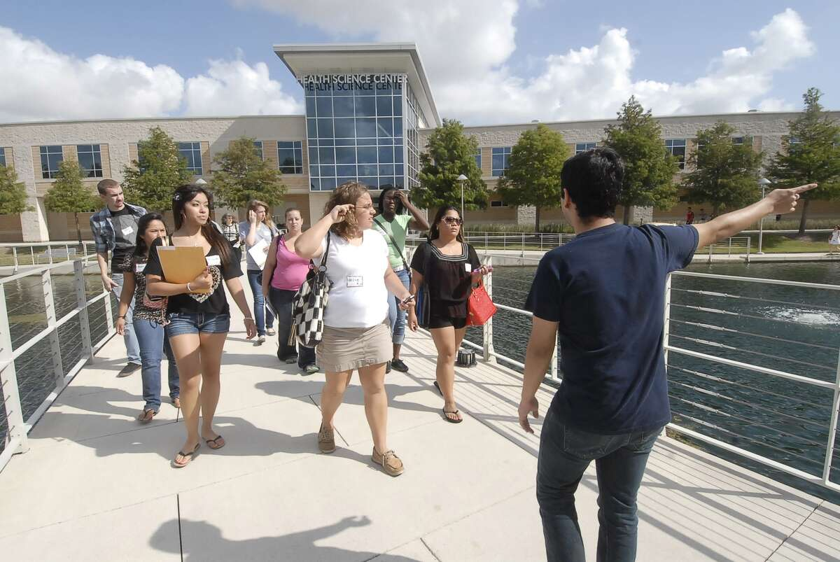 A student leader helps conduct tours for new students at Lone Star College-CyFair. The college is organizing summer information sessions.