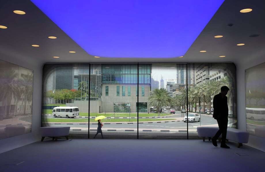 """In this Tuesday, May 31, 2016 photo, a man walks inside what the United Arab Emirates says is the world's first functional office building made using three-dimensional printer technology, in Dubai, United Arab Emirates. Dubai's ruler quietly inaugurated the whitewashed buildings last week, not far from the site of a planned """"Museum of the Future"""" that's due to open in 2018. Dubai hopes the project will kick-start its plans to transform the sheikhdom into an incubator for emerging technologies. (AP Photo/Kamran Jebreili) Photo: Kamran Jebreili / Associated Press / Copyright 2016 The Associated Press. All rights reserved. This material may not be published, broadcast, rewritten or redistribu"""