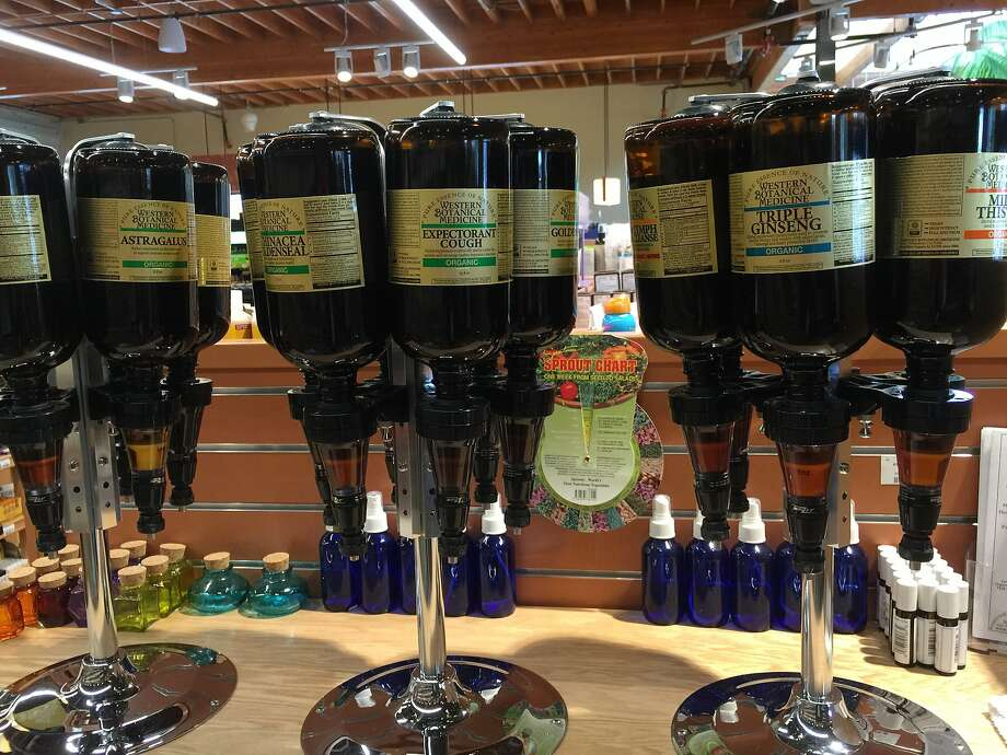 Bottle your own health remedies in the health section at Good Earth grocery store in Mill Valley. Photo: Amanda Gold/The Chronicle
