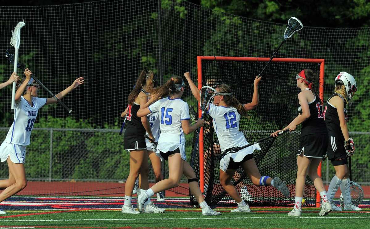 Darien Susannah Ropp(12) celebrates her winning goal against New Canaan in a FCIAC Girls Lacrosse Final at Brien McMahon High School in Norwalk, Conn. on May 26, 2016. Darien defeated New Canaan 12-11 in over-time.