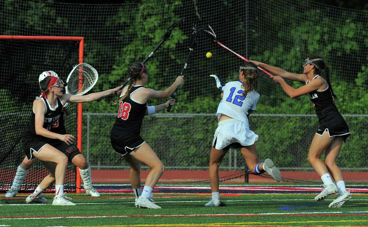 Darien Susannah Ropp fires the winning goal shot against New Canaan goal keeper Cameron Blair in a FCIAC Girls Lacrosse Final at Brien McMahon High School in Norwalk, Conn. on May 26, 2016. Darien defeated New Canaan 12-11 in over-time.