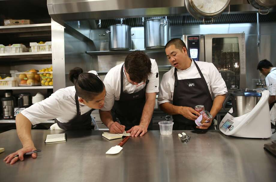 Sous chef James Wong (right) teaches cooks how to make coconut foam during prep at In Situ restaurant at SFMOMA. Photo: Liz Hafalia, The Chronicle
