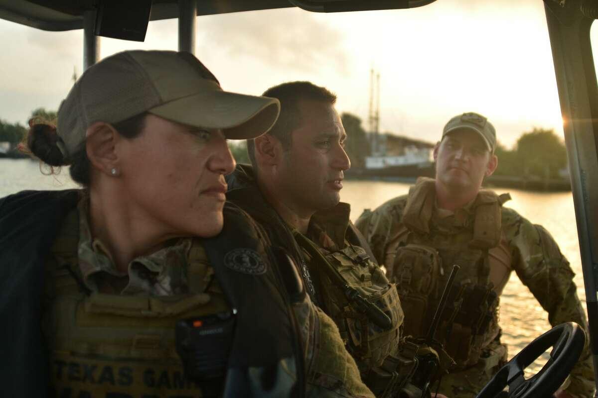 Wardens Carmen Rickel and Luis Sosa patrol the Rio Grande River.