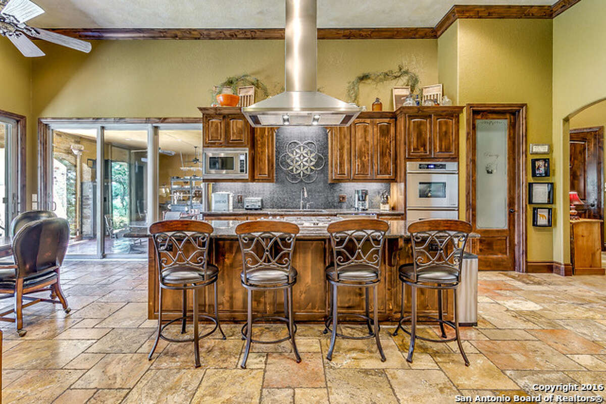 1. 454 Sidney Shores Drive: $1.45 million4 beds / 4.5 baths / 4,553 square feetFeatures: Located on two acres, travertine floors, entertainment bar, gourmet kitchen with glass backsplash, two gazebos with fire pits, private pool and spa