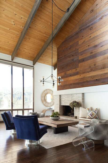 The Mill Valley home of Elena Calabrese complements her California modern aesthetic with its big windows and dramatic fireplace. Photo: Suzanna Scott Photography