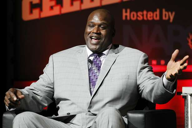 FILE - In this, Nov. 23, 2014, file photo, Shaquille O'Neal reacts as he talks about his career during a National Collegiate Basketball Hall of Fame induction event in Kansas City, Mo. O'Neal appears as an undercover Lyft driver in a video published by the company on YouTube June 1, 2016. (AP Photo/Colin E. Braley, File)
