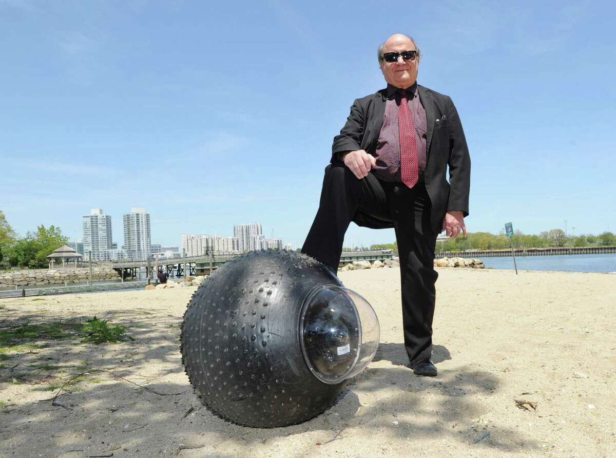 GuardBot Inc. President Peter Muhlrad with his Guardbot, a spherical amphibious robotic vehicle, at Southfield Park in Stamford.