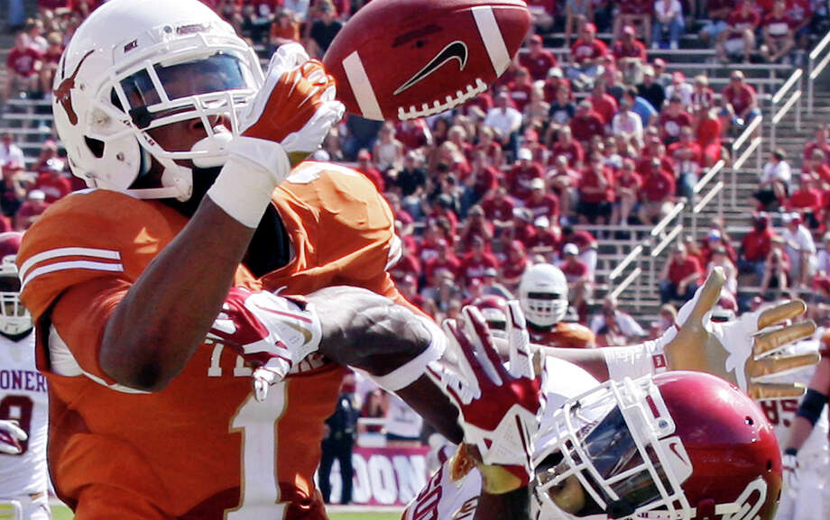 Texas Longhorns' Mike Davis misses a pass as he is defended by Oklahoma Sooners' Cortez Johnson during second half action of the Red River Rivalry on Oct. 12, 2013 at Cotton Bowl in Dallas. Photo: Edward A. Ornelas /San Antonio Express-News / © 2013 San Antonio Express-News