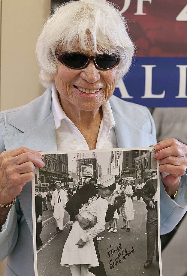"SAN FRANCISCO - APRIL 20:  Ninety one-year-old Edith Shain poses with a photo of her famous kiss with a sailor on V-J Day at the end of World War II April 20, 2010 in San Francisco, California. Shain, who claims to be the nurse in the famous kiss picture that was photographed by Alfred Eisenstaedt was meeting with veterans at the VA Hospital as part of her ""Keep the Spirit Alive"" campaign that raises awareness about the 65th anniversary of World War II.  (Photo by Justin Sullivan/Getty Images) Photo: Getty Images"