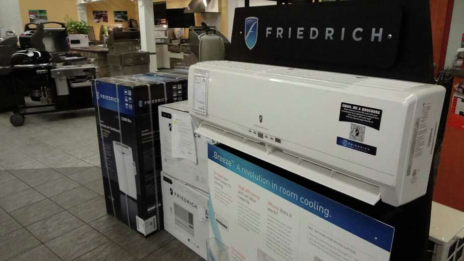 Three air conditioning options on display on June 1, 2016 at Aitoro in Norwalk, Conn.: portable, window-mounted and ductless mini split AC units from Friedrich. Photo: Alexander Soule / Hearst Connecticut Media / Stamford Advocate