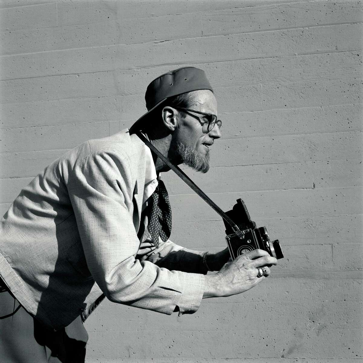 """Earl Leaf, known as the """"Beatnik Photographer,"""" strikes animated poses for Petersen Publishing photographer Bob D'Olivo. Leaf began his photography career in the 1930s but became known for his work in the 1950s and 1960s with starlets like Marilyn Monroe."""