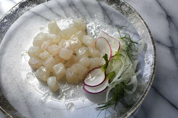 Raw halibut with lemon olive oil and radishes on Wednesday, June 1, 2016 in San Francisco, Calif.