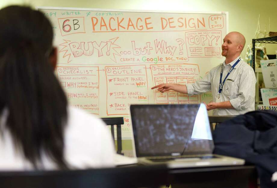 Upper School Design teacher Phil Lohmeyer shows project guidelines for the sixth-grade Design class' branding and packaging project at Whitby School in Greenwich, Conn. Tuesday, May 24, 2016. Students came up with an original product and designed the product packaging and advertising for the product. Photo: Tyler Sizemore / Hearst Connecticut Media / Greenwich Time