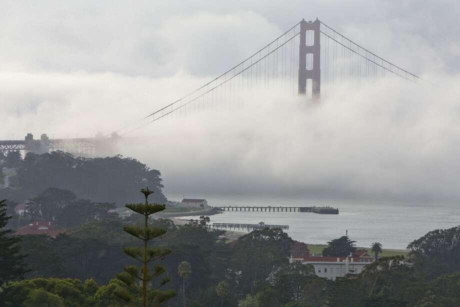 Fog rolls in over the Golden Gate Bridge in San Francisco on Friday, April 8, 2016. (AP Photo/Jacquelyn Martin) Photo: Jacquelyn Martin, AP