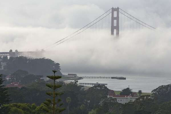 Fog rolls in over the Golden Gate Bridge as President Barack Obama attends a fundraiser in San Francisco, Friday, April 8, 2016. (AP Photo/Jacquelyn Martin)