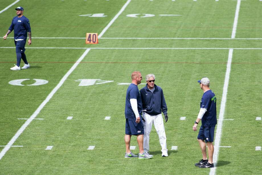 Seahawks head coach Pete Carroll talks with coaches during organized team activities practice at Virginia Mason Athletic Center in Renton on Wednesday, June 1, 2016. Photo: Grant Hindsley, SEATTLEPI.COM / SEATTLEPI.COM