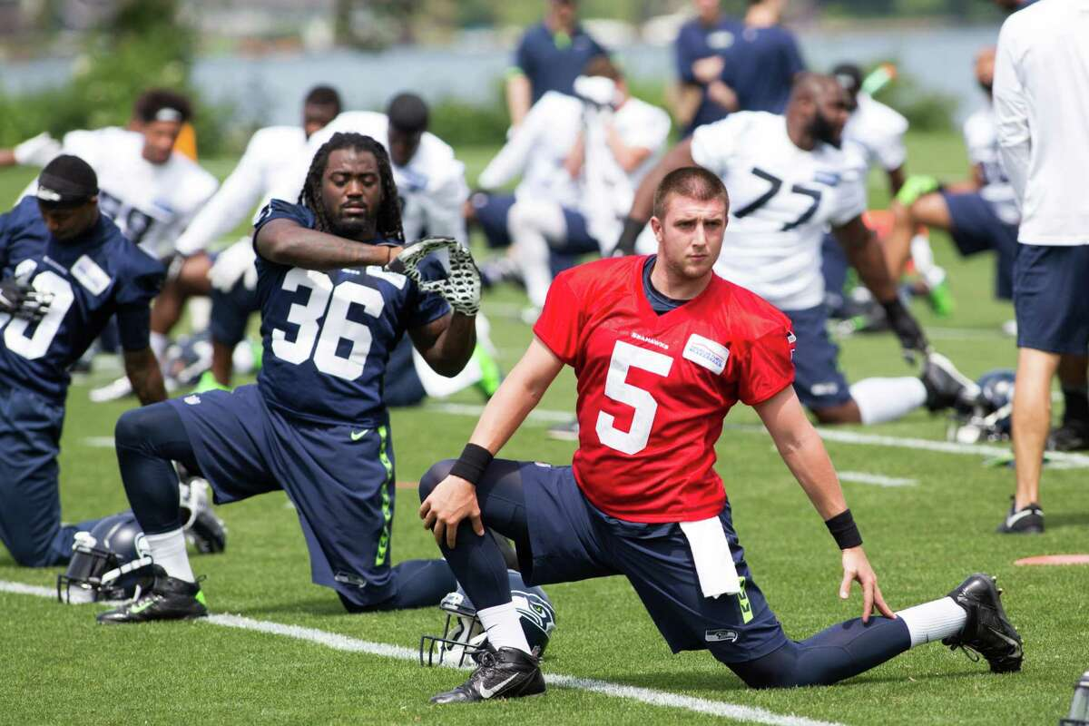 Seahawks quarterback Jake Heaps, right, stretches during organized team activities practice at Virginia Mason Athletic Center in Renton on Wednesday, June 1, 2016.