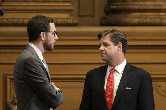 Supervisor's Scott Wiener, (left) and Mark Farrell discuss the proposals as the San Francisco Board of Supervisor prepared to vote on competing measures to regulate Airbnb and other short-term rental services in San Francisco, Calif., on Tues. July 14, 2015.