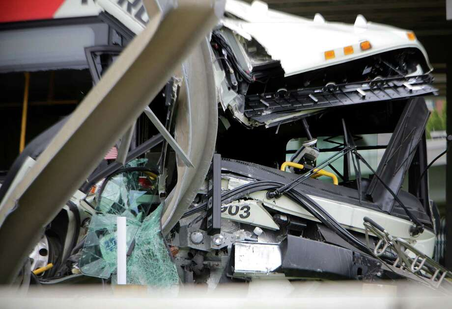 A Metro bus sits where it crashed into the sign for Interstate 10 at Runnels Street when it was hit by a pickup truck that failed to yield, according to Metro spokesman Jerome Gray, Wednesday, June 1, 2016, in Houston. Photo: Mark Mulligan, Houston Chronicle / © 2016 Houston Chronicle