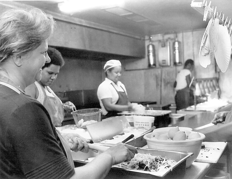 Cindy Barnes makes coleslaw in the kitchen at Sartin's Seafood in Sabine Pass, May 1, 1987.  Enterprise archive photo Photo: Ryan Pelham / ©2016 The Beaumont Enterprise/Ryan Pelham
