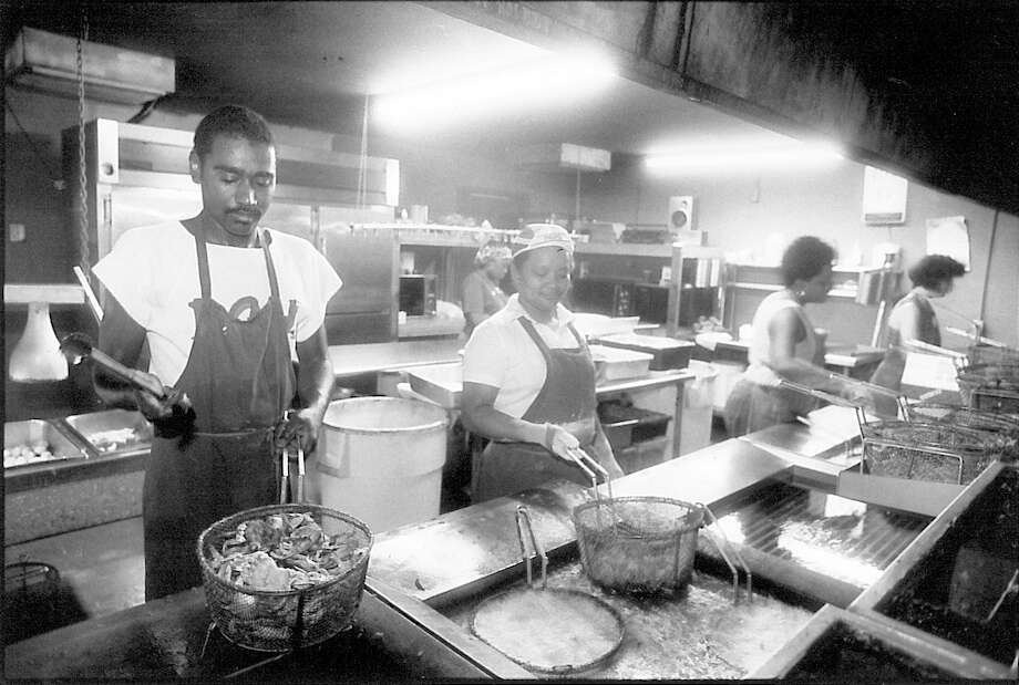 Darryl Jacobs, Linda Jacobs, Lidya Lewis and Thoa Pham Alice work in the kitchen at Sartin's Seafood in Sabine Pass, May 1, 1987.  Enterprise archive photo Photo: Ryan Pelham / ©2016 The Beaumont Enterprise/Ryan Pelham