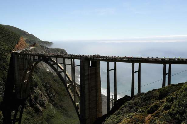 BIG SUR, CA - MAY 18:  The peloton rides over the Bixby Bridge on their way from Morro Bay to Monterey County Mazda Raceway Laguna Seca during Stage 4 of the Amgen Tour of California on May 18, 2016 in Big Sur, California.  (Photo by Ezra Shaw/Getty Images)