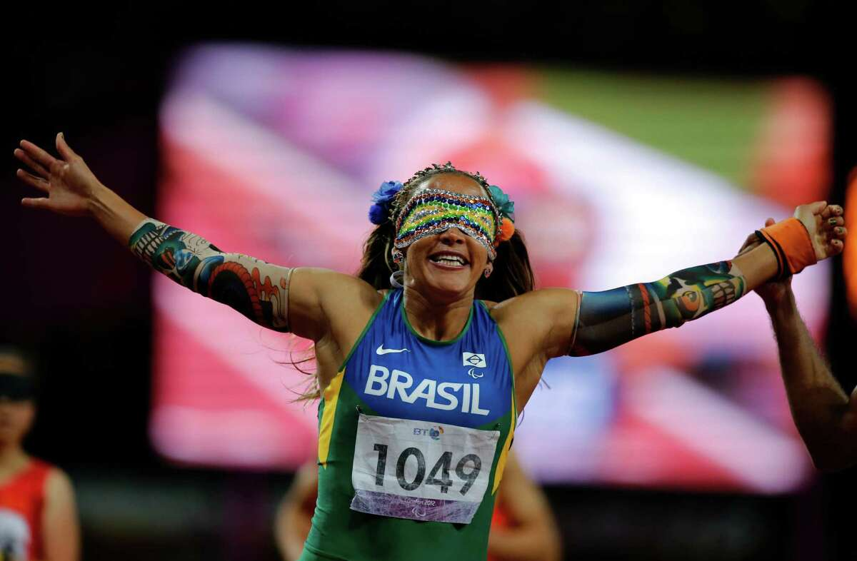 FILE.- In this Sept. 5, 2012 file photo Brazil's Terezinha Guihermina wins the Women's 100m T11 Final at the 2012 Paralympics in London. The countdown clock for the Paralympic Games reaches 100 days on Monday with about 4,300 athletes participating, far fewer than the 10,500 in the Olympics. The Paralympic Games open Sept. 7.(AP Photo/Emilio Morenatti, File) ORG XMIT: XEM103