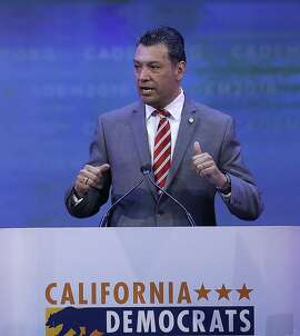 In this Saturday, Feb. 27, 2016, photo California Secretary of State Alex Padilla gestures while speaking before the California Democrats State Convention in San Jose, Calif. �There�s no other fundamental right we have as citizens that requires you to register or fill out a form,� said Padilla, who advocated for a California legislation for automatic registration bills. (AP Photo/Ben Margot)