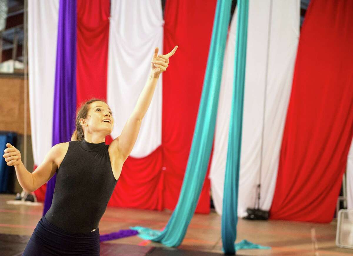 """Corie Altaffer dances during a rehearsal for AtticRep's """"14"""" at Aerial Horizon."""