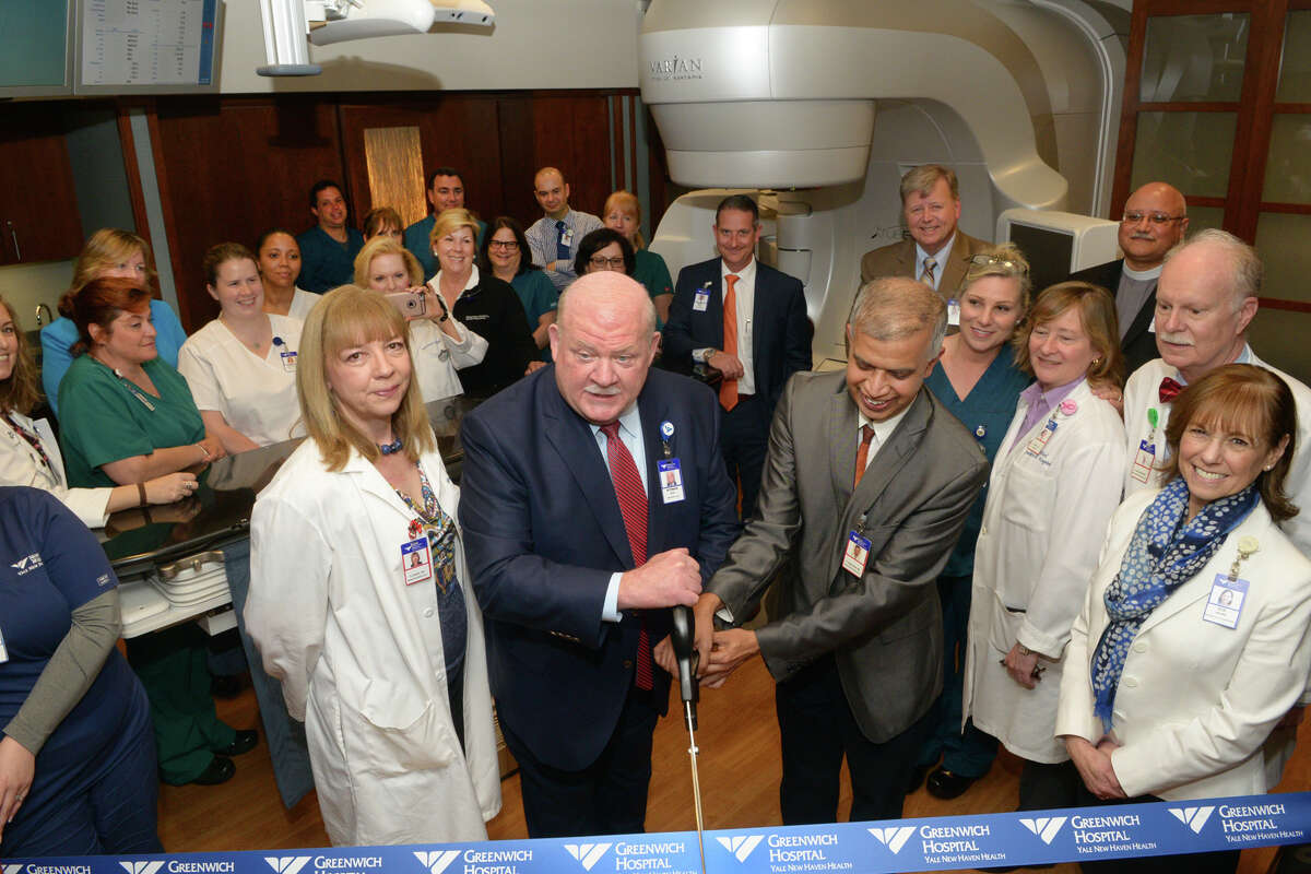 Greenwich Hospital President Norman G. Roth (left) and Ashwatha Narayana, MD, cut the ribbon during a ceremony to unveil the new TrueBeam radiation therapy system.