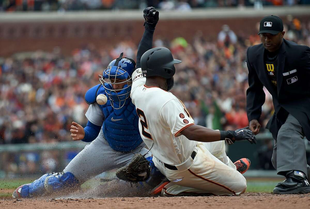 SAN FRANCISCO, CALIFORNIA - APRIL 10: Denard Span #2 of the San Francisco Giants scores on a two-run rbi double from Joe Panik #12 (not pictured), beating the throw to catcher Austin Barnes #28 of the Los Angeles Dodgers in the bottom of the six inning at AT&T Park on April 10, 2016 in San Francisco, California. (Photo by Thearon W. Henderson/Getty Images)