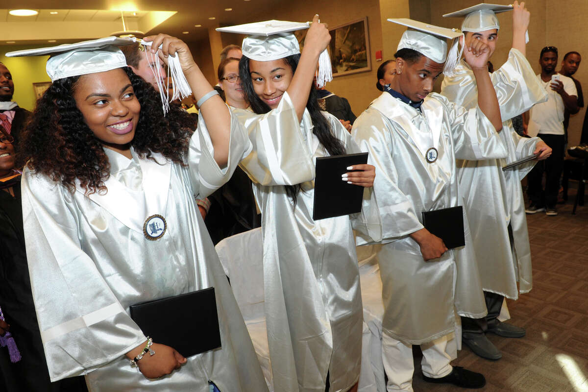 From left, Tiajah Smith, Jukara Cuffe, Kaison Carter and Anthony Nieves are the first class of graduates, seen here during the First Annual Commencement for Capital Preparatory Harbor School, held at Housatonic Community College in Bridgeport, Conn. June 1, 2016.