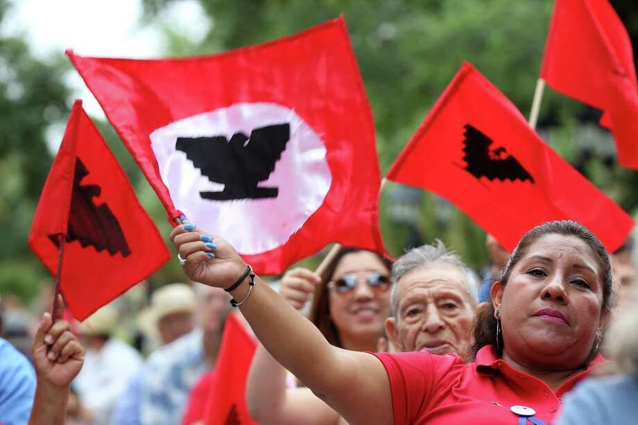 Leticia Sanchez, 47, of Alamo, Texas, waves her flag in support as people gather to commemorate the 50th anniversary of the 1966 Melon Strike in Starr County during a ceremony at the town square in Rio Grande City, Wednesday, June 1, 2016. The strike was started in an effort to raise the minimum wage of farmworkers from 25-cents an hour to $1.25. Photo: JERRY LARA, Staff / San Antonio Express-News / © 2016 San Antonio Express-News