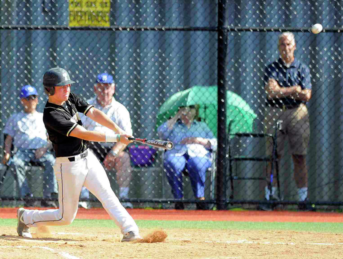 Trumbull Vincent DeRubeis (8) connects on a fourth inning two-run homer against Darien in a second round CIAC Class LL baseball game at Darien High School in Darien on June 1, 2016. Trumbull defeated Darien 5-4.