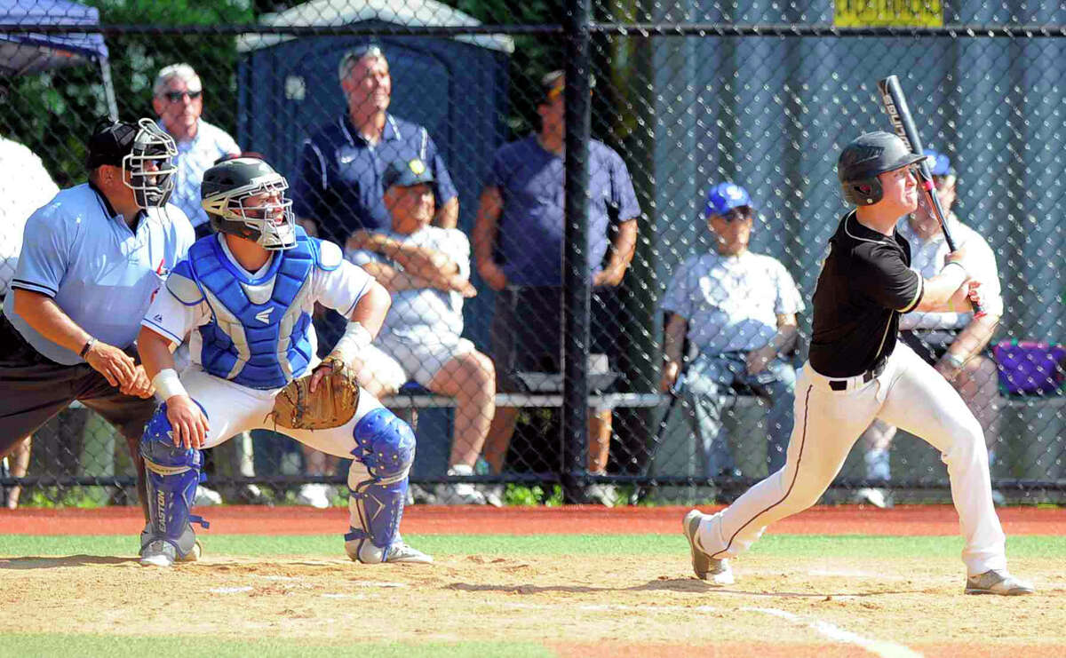 Trumbull Vincent DeRubeis (8) follows his fourth inning two-run homer out of the park against Darien in a second round CIAC Class LL baseball game at Darien High School in Darien on June 1, 2016. Trumbull defeated Darien 5-4.