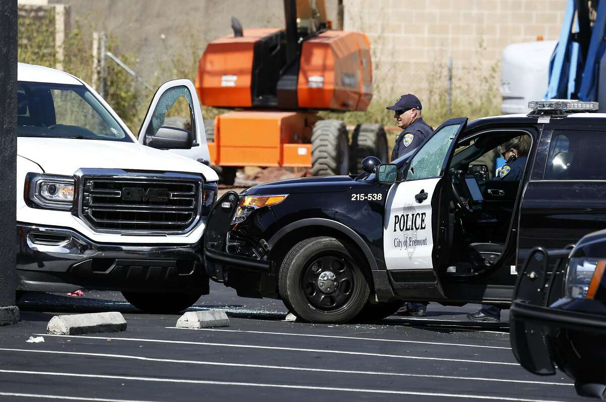 Two police officers work the scene of an officer-involved shooting near Fremont Boulevard and Irvington Avenue in Fremont, California, on Wednesday, June 1, 2016.