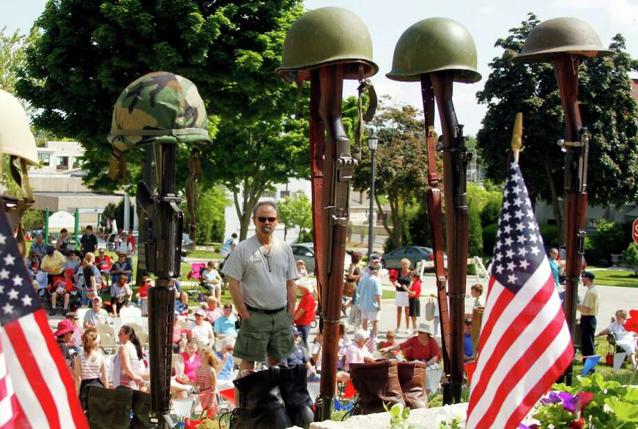 Bill Tybring looks over the Memorial Day ceremony setup Monday, May 30, 2016, in West Bend, Wis. (John Ehlke/West Bend Daily News via AP) MANDATORY CREDIT Photo: John Ehlke, MBR / The West Bend Daily News
