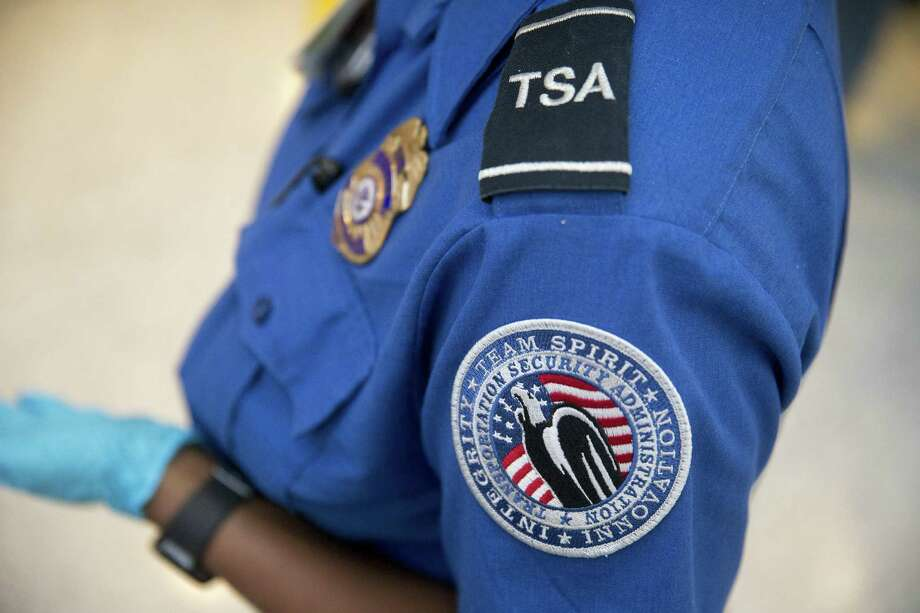 A Transportation Security Administration (TSA) officer stands in the TSA pre-check area at Dulles International Airport in Dulles, Virginia. (Andrew Harrer /  Bloomberg) Photo: Andrew Harrer, Staff / © 2016 Bloomberg Finance LP