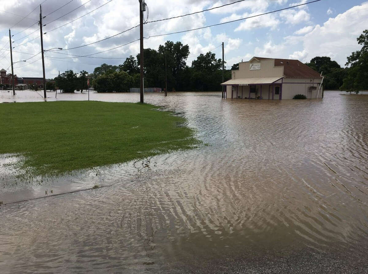 In Richmond, flooding from the Brazos River submerges Wessendorff Park and Preston Street on Wednesday.