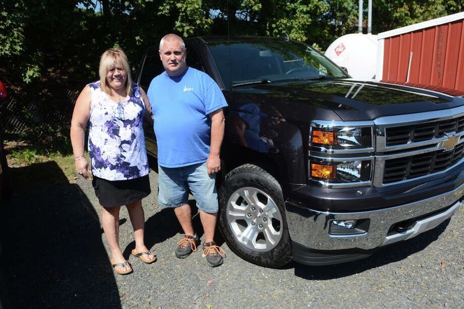 Joan Lechleitner and Kerry Titus bought a new Chevrolet Silverado 1500 Z71 with money they won in the Cash 5 lottery game in September.  Photo: Nick Meyer, MBO / The Republican-Herald
