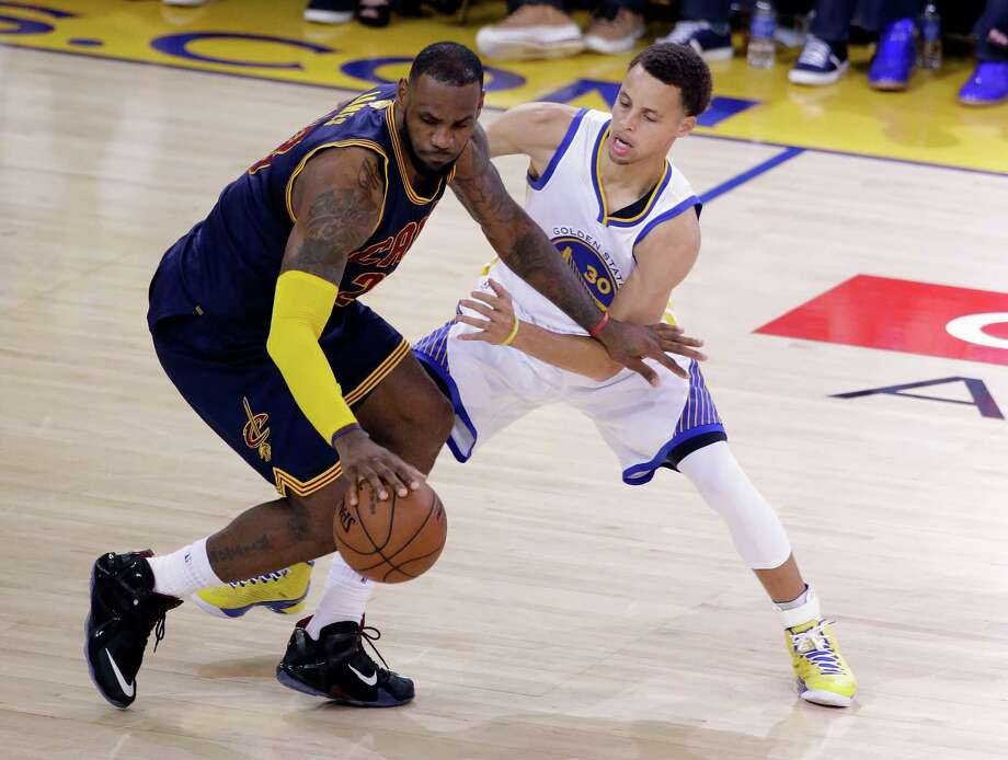 Luckily for the Warriors, the outcome of the NBA Finals will not be based on the physical stature of mar-quee players LeBron James, left, and Stephen Curry. Photo: Eric Risberg, STF / AP