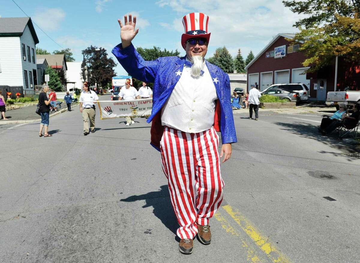 Oriental Shriner, Michael Blaine, dressed as Uncle Sam, waves to the crowd during the 40th Annual Uncle Sam Birthday Parade on Sunday, Sept. 13, 2015, in Lansingburgh, N.Y. (Paul Buckowski / Times Union)