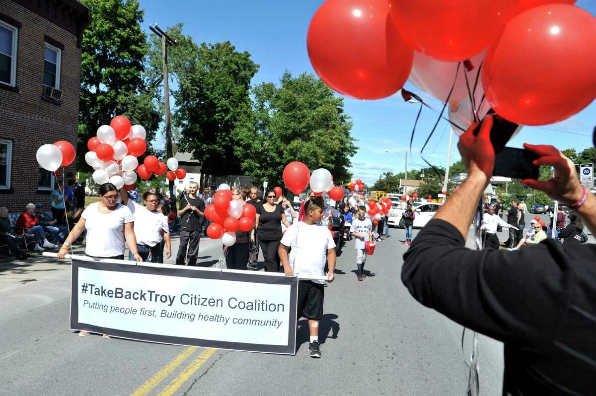 Members of the Take Back Troy Citizen Coalition march down Fifth Ave. during the 39th annual Uncle Sam Parade on Sunday, Sept. 14, 2014, in Lansingburgh, N.Y. (Paul Buckowski / Times Union)