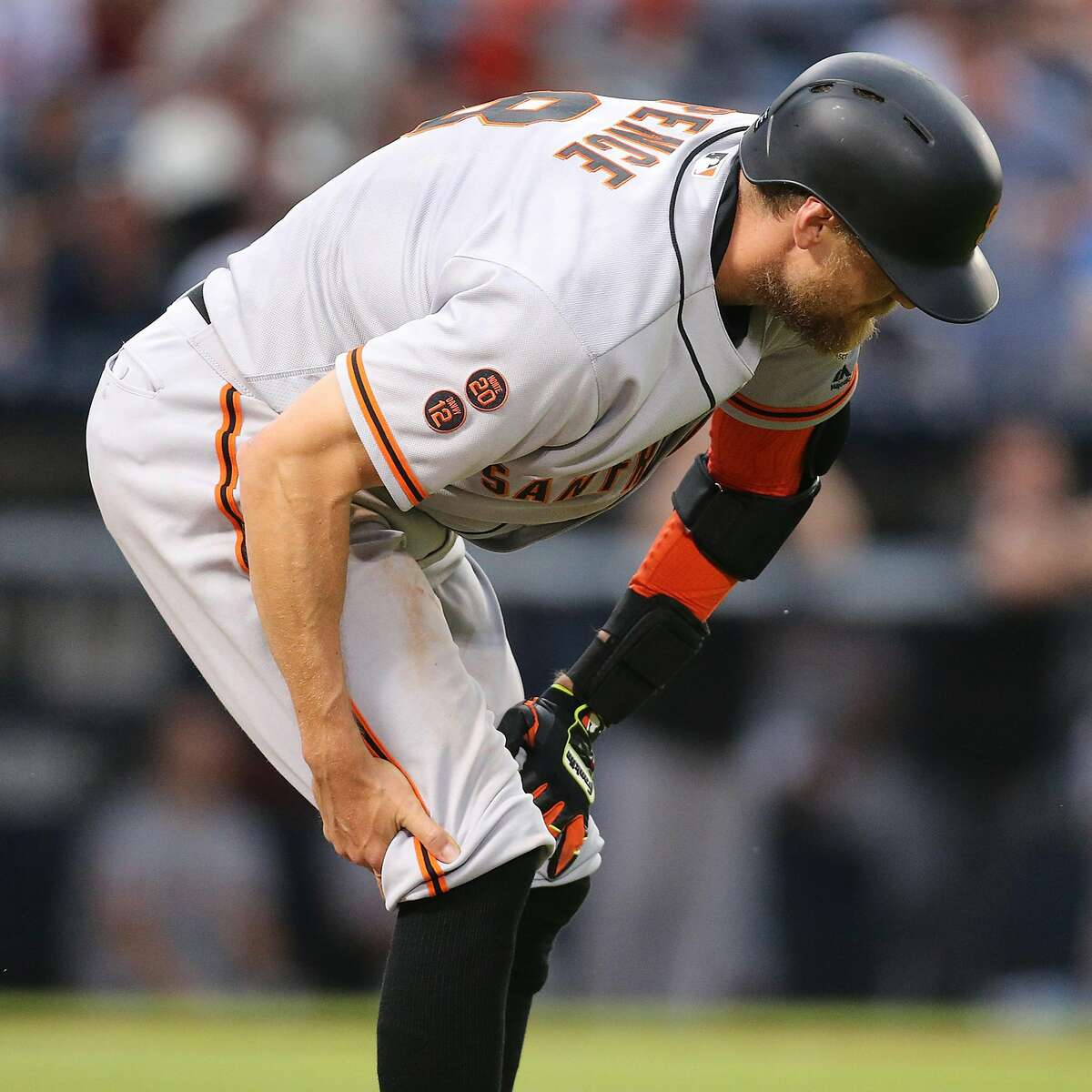 The San Francisco Giants' Hunter Pence grabs his leg, pulling up short of first base during the fourth inning against the Atlanta Braves at Turner Field in Atlanta on Wednesday, June 1, 2016. (Curtis Compton/Atlanta Journal-Constitution/TNS)