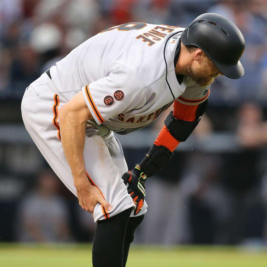 Hunter Pence hurt his right hamstring while running. Photo: Curtis Compton, TNS