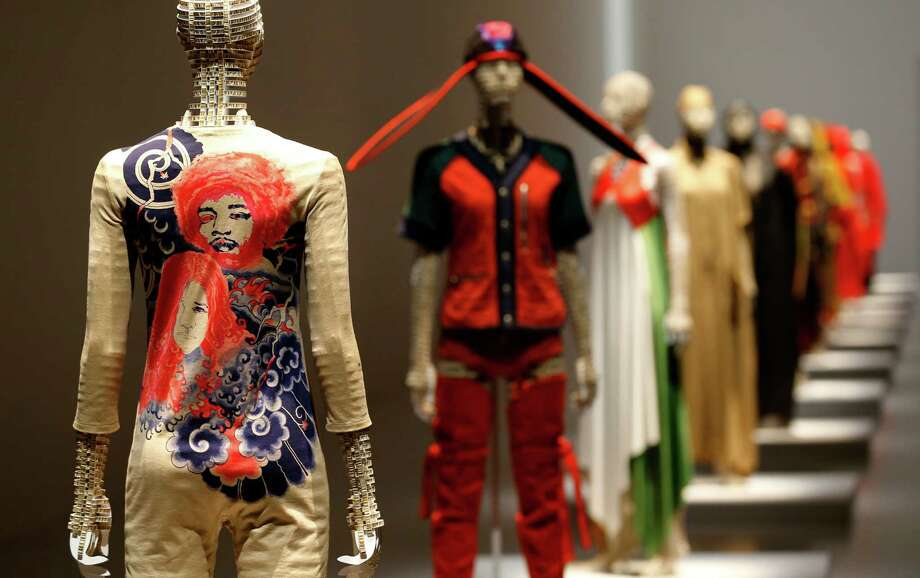 Pieces of designer Issey Miyake's collection are displayed at the National Art Center in Tokyo, Japan, Tuesday, May 31, 2016. Although he's behind one of the biggest fashion brands to come out of Japan, Issey Miyake detests being called a fashion designer. Maybe a designer, even a sculptor, but not of that frivolous, trend-watching, conspicuous consumption known as fashion. What he has pursued since he started in the 1970s is more timeless. His down-to-earth clothing is meant to celebrate the human body. And it's anyone's or everyone's body _ any race, build, size or age. (AP Photo/Shizuo Kambayashi) Photo: Shizuo Kambayashi, STF / Copyright 2016 The Associated Press. All rights reserved. This material may not be published, broadcast, rewritten or redistribu