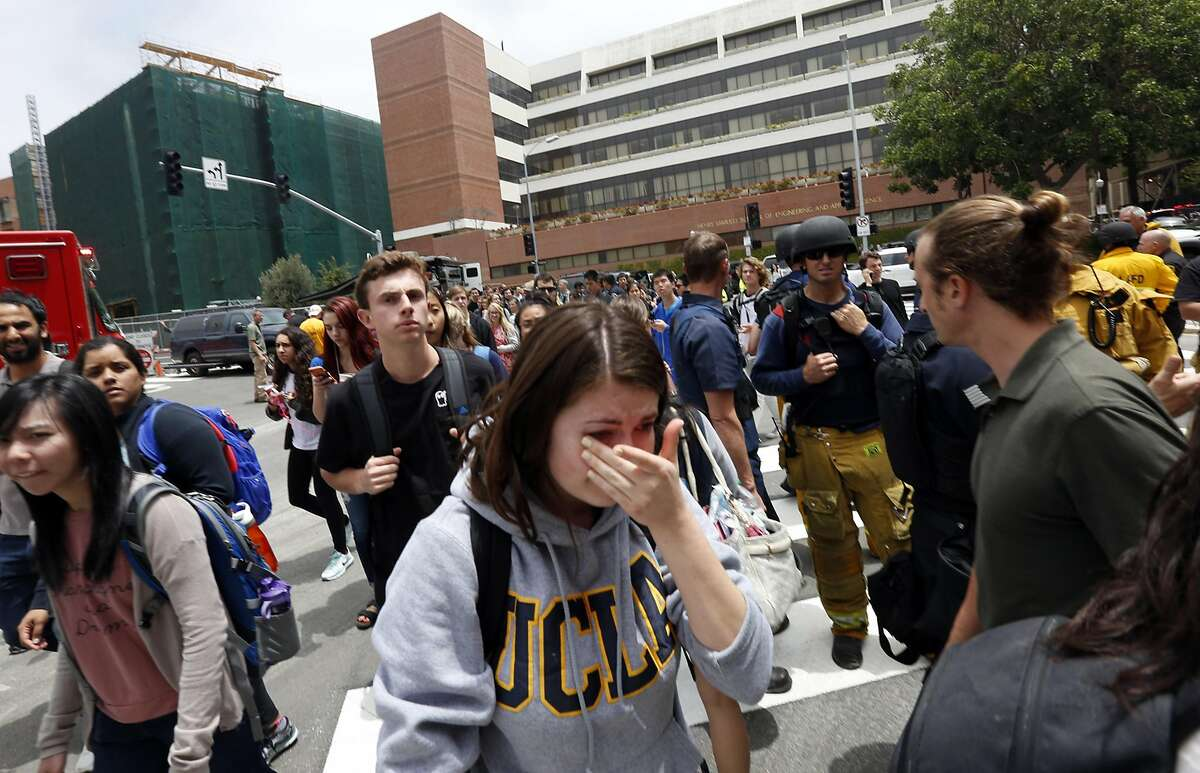 A tearful UCLA student joins hundreds of other students as they leave the UCLA campus after the lockdown was called off on Wednesday, June 1, 2016. (Genaro Molina/Los Angeles Times/TNS)