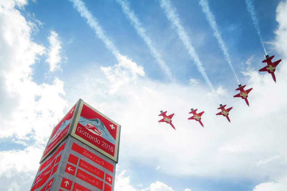 The Patrouille Suisse performs on the opening day of the Gotthard rail tunnel, at the fairground at the southern portal in Pollegio, Switzerland, Wednesday, June 1, 2016. The construction of the 57 kilometer long tunnel began in 1999, the breakthrough was in 2010. (Samuel Golay/Keystone,Ti-Press via AP) Photo: Samuel Golay, SUB / KEYSTONE/TI-PRESS