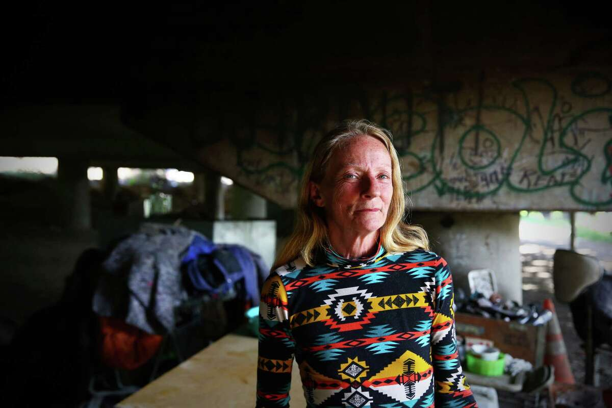 """Mary Jordan poses for a portrait near her campsite in the """"Jungle,"""" an area under Interstate 5 in South Seattle inhabited by hundreds of Seattle's homeless, Tuesday, May 31, 2016. Jordan has lived there only for a few weeks, but she prefers it to shelters where fights occur and she may risk bed bugs. The city is proposing to clean out the area in the next month, forcing those who call it home to find another place to live."""