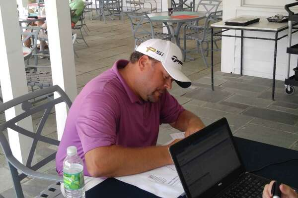Scott Berliner, assistant pro at Hiland Golf Club, signs his scorecard Wednesday, June 1, after winning his sixth consecutive Northeastern New York PGA Stroke Play Championship at the Taconic Golf Club in Williamstown, Mass. (Pete Dougherty/Times Union)
